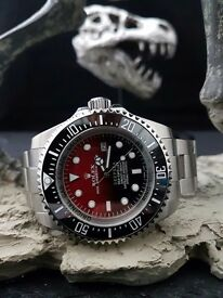 Red/Black fade SeaDweller with black ceramic bezel & a all silver oyster bracelet comes in Rolex box