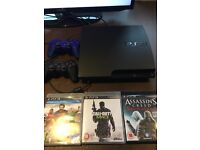 PS3 slim 150GB 2 controllers 3 games