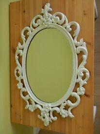 white oval mirror