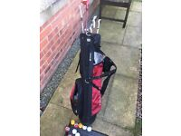 Children's golf set to include a selection of clubs a bag and some golf balls bargain £15