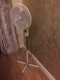 Stand fan moves and adjusts different settings