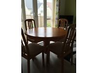 Forest furnishing circular pedestal dining table and 4 matching chairs.