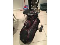 Wilson deep red fat shaft golf clubs, bag and trolly