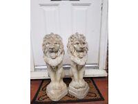 2x stone lion statues