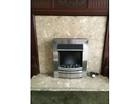 Silver finish electric fire suitable for fireplace