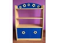 Football shelving unit with sliding doors. In great condition.