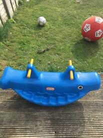 Little tikes seesaw whale.