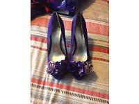 Ladies purple high heeled shoes