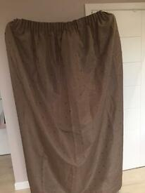 Pair of lined pencil pleat brown curtains.