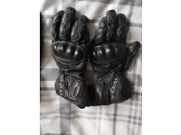 Leather motorcycle jacket and trousers, size M - L, 2 pairs of gloves and helmet for sale.