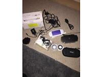 PSP with two games and accessories