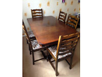 6 SEATER DARK WOOD TABLE EXTENDS TO SEAT 10 PEOPLE - 6 CHAIRS INCLUDED