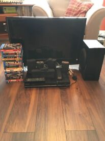 TV with blu ray player with surround sound and 22 blu ray dvds