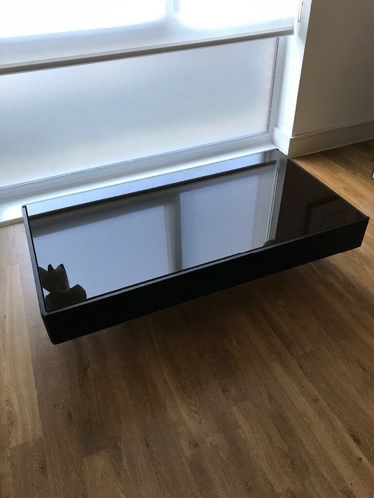 Dark wood / glass coffee table with drawers