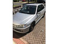 Silver Peugeot 306 2.0 HDI, half leather interior.