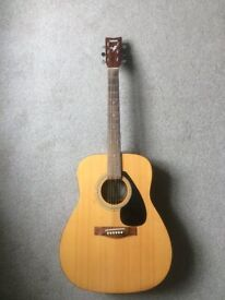 Yamaha acoustic guitar. Steel strings, good sound, in tune and played regularly. Full size.