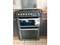 HOTPOINT HUD61G Dual Fuel Cooker - gas hob and double fan oven. Graphite. For collection