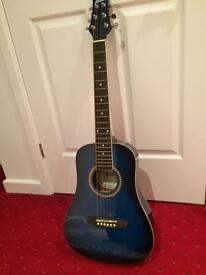Acoustic guitar with starter books etc