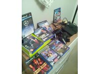 PlayStation 2 slim,2 controllers, 8 games
