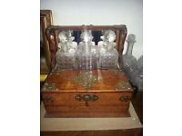 Oak Tantalus with three decanters and 'secret' pop out drawer