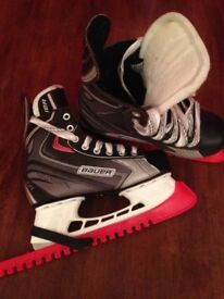 Bauer Ice Skates and guards. Size 5.5.