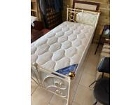 Julian Bowen single bed White metal frame Mattress is in excellent condition .