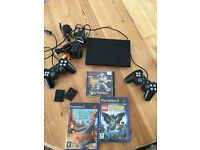 PlayStation 2 slim console + 2 controllers & games PS2