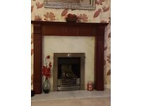 Fire surround with real marble grey inset and hearth