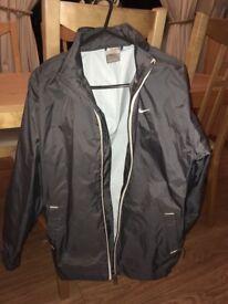 Nike grey rain jacket. Large boys