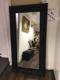 Large black framed mirror. 183 x 93 cms