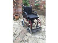 Enigma lightweight transit wheelchair £100 o.v.n.o