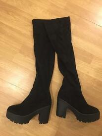 Black, never worn boots size 5
