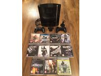 PS3 2 CONTROLLERS 31 GAMES PLUS MORE