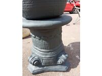 Large grey stone planter with stand