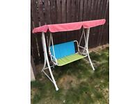 Kids swinging outdoor seat