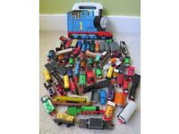 This is a box of metal and plastic characters from Thomas the Tank Engine Range.