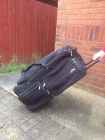 Large Delsey wheeled suitcase