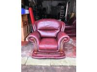Pair of burgundy leather armchairs