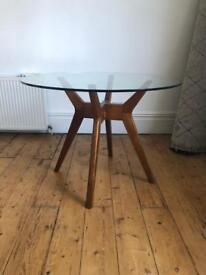 West Elm round glass top dining table