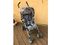 "Tippitoes ""Spark"" stroller with rain cover"