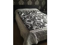 Black leather kingsize bed with memory foam mattreas