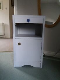Bedside table. Light blue with cupboard, drawer and shelf area.