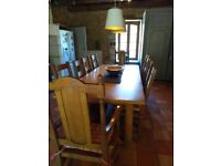 Oak Dining Table with 10 Chairs.