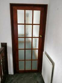 Glass panelled wooden door
