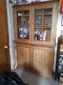 Old pine dresser. 2 door storage below and glazed doors on top comes apart in 2 pieces