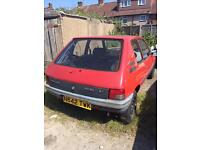 2 Peugeot 205's. A 1995 petrol (lighter red), and 1987 diesel.