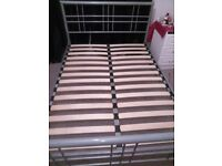 one double bed frame with two doubles mattresses