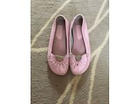 Flat pink shoes