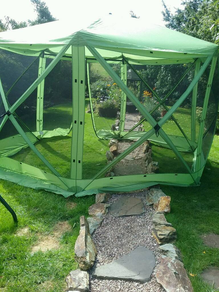 Gazeboin Ashbourne, DerbyshireGumtree - Green 6 sided gazebo with side curtains. New but as a slight hole in the net as shown. Would not notice it with side curtain on. Its on the back panel