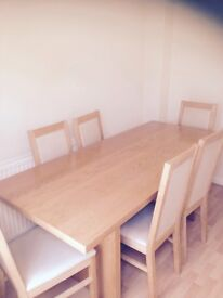 6 seater oak dining table with cream leather and oak high back chairs